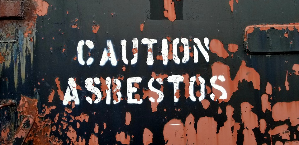 caution asbestos painted sign